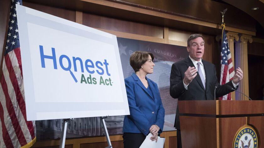 Senators Mark Warner (D-Va.) and Amy Klobuchar (D-Minn.) introduce the 'Honest Ads Act' at a news conference on Capitol Hill in Washington on Oct. 19.