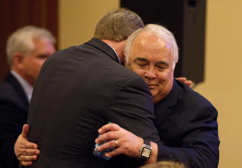 Ron Fowler, whose donation will help fund USD's new baseball facility, hugs USD's atheletic director, Ky Snyder, at a press conference announcing his donation.
