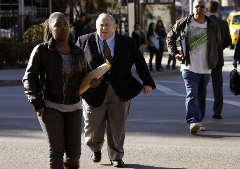 Robert Rizzo walks toward the federal federal courthouse earlier this week.