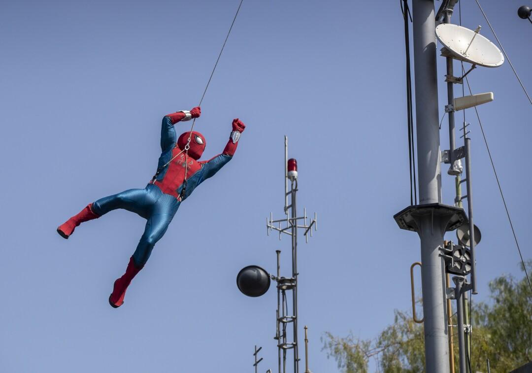 A robot Spider-Man soars through the air