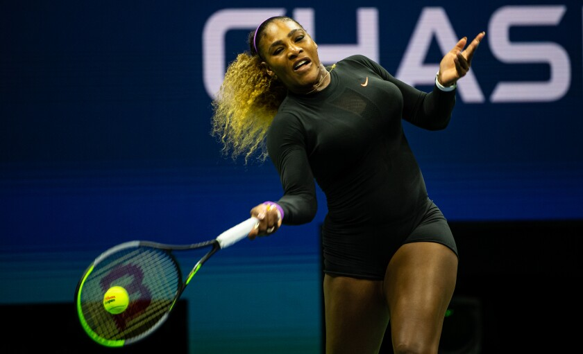 Serena Williams hits a forehand during her victory over Maria Sharapova in the first round of the U.S. Open on Monday.