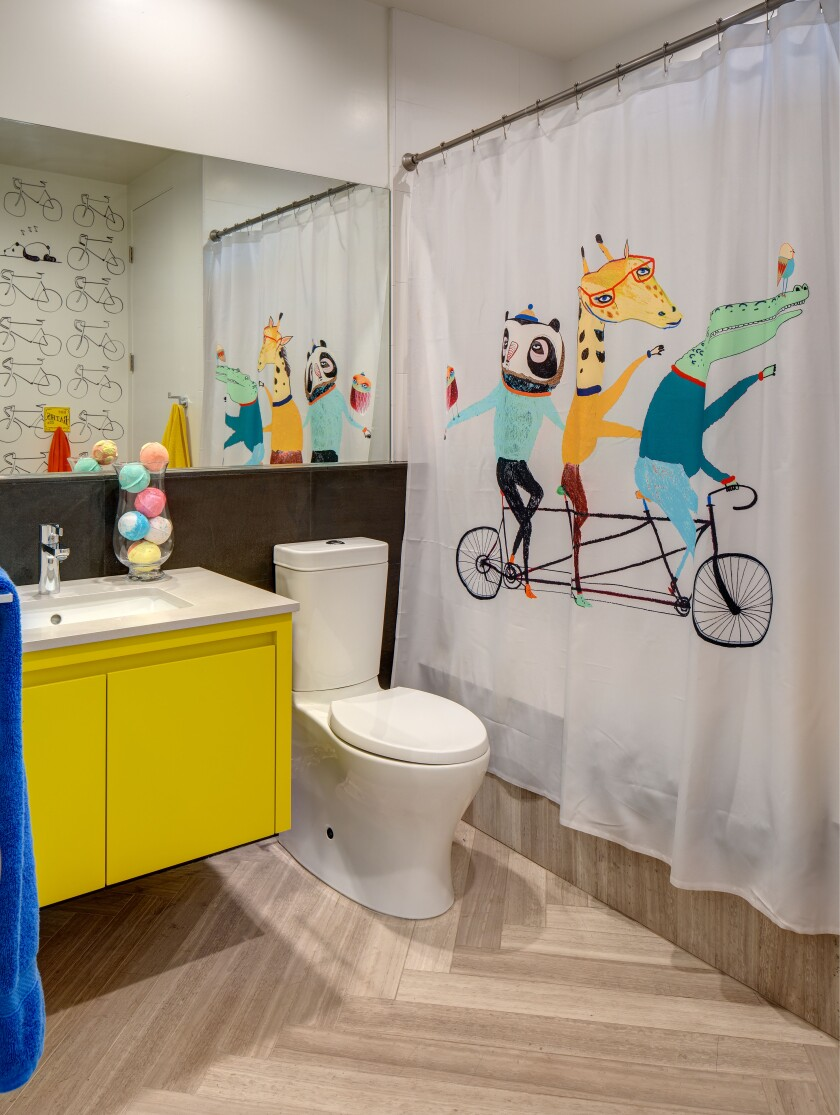 Use fun, colors, patterns and objects for a kids' bathroom - from shower curtains and towels, wallpaper and paint.