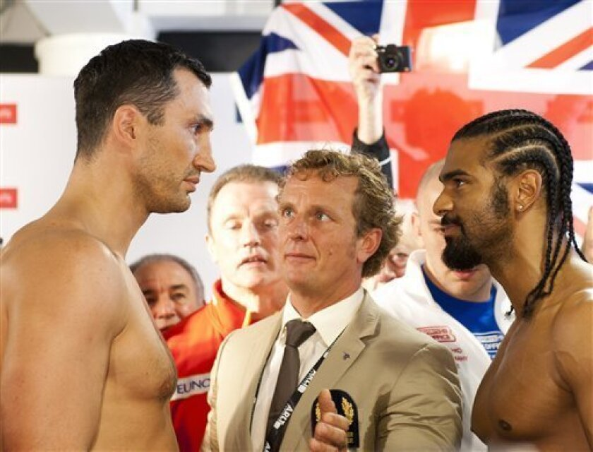 WBO and IBF champion Wladimir Klitschko of the Ukraine and British WBA champion David Haye, from left, stand face to face after official weighing ahead of their Saturday's heavyweight title bout in Hamburg, northern Germany, Friday, July 1, 2011. (AP Photo/dapd, Stefan Simonsen)