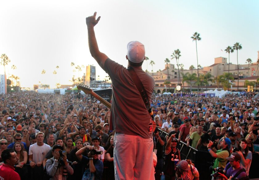 SAN DIEGO, CA-SEPTEMBER 19, 2015: Miles Doughty of Slightly Stoopid pumps up crowd at the Grandview stage during day two of KAABOO Del Mar.