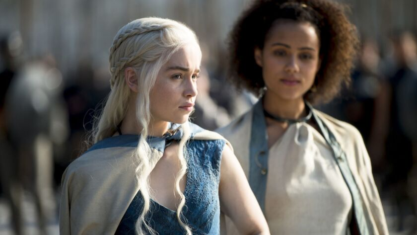 GAME OF THRONES season 4: Emilia Clarke, Nathalie Emmanuel. photo: Macall B. Polay