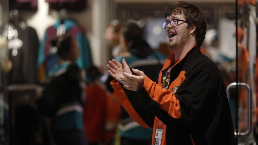 Anaheim, CA November 18, 2018: Trevor Hendershot, 28, joyfully stands outside the Ducks' team stor