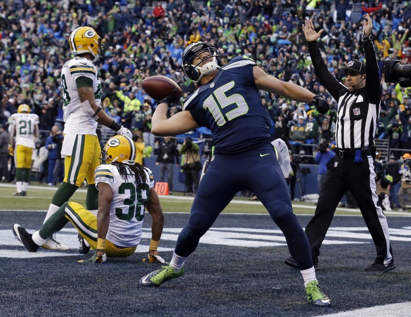 Seahawks receiver Jermaine Kearse celebrates after scoring the game-winning touchdown against the Packers in overtime Sunday.