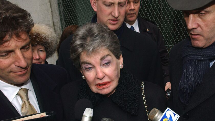 Leona Helmsley is surrounded by her attorneys in New York on Jan. 28, 2003.