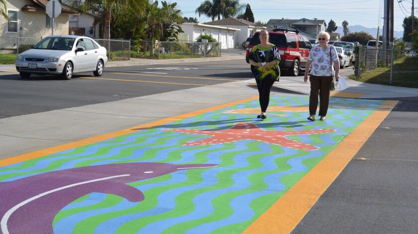 South Bay Union School District board members Melanie Ellsworth, left, and Chris Brown check out one of two new crosswalks at the intersection of 13th Street and Grove Avenue in Imperial Beach during a ribbon cutting ceremony in 2016.