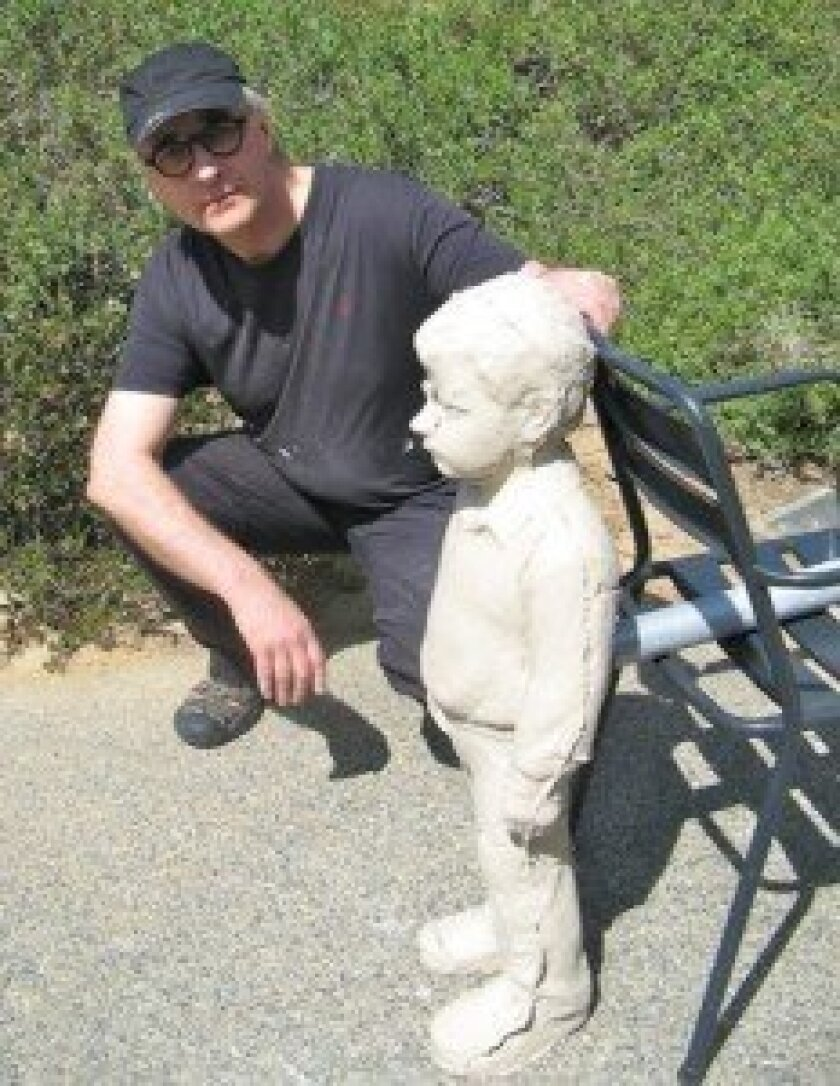 armo Mäkilä, the current artist-in-residence, with one of his 'Clay Boys'