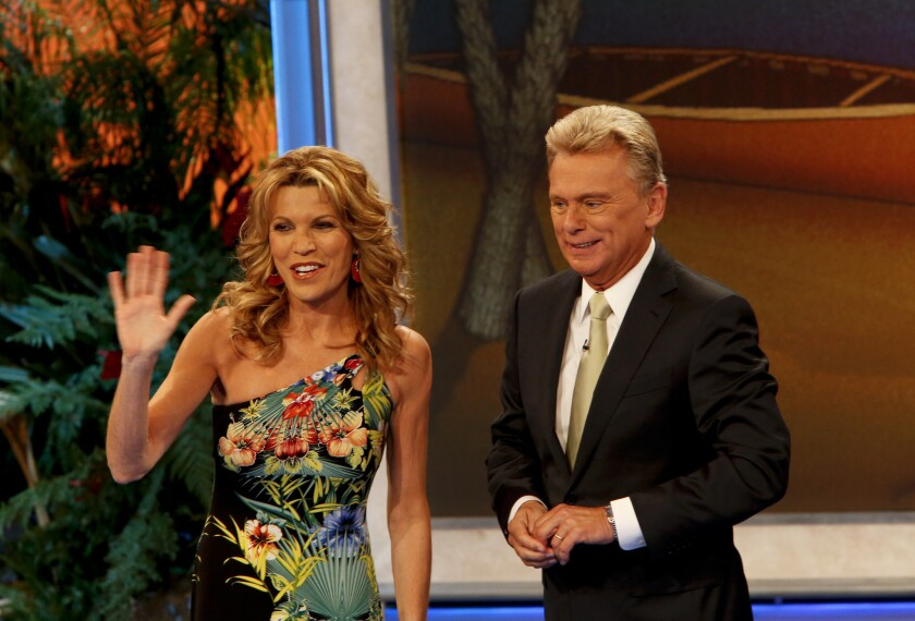 "Vanna White, left, is stepping in for Pat Sajak as host of ""Wheel of Fortune"" for three weeks."