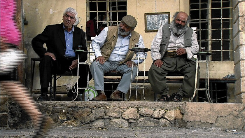 """Teahouse regulars (Ali Cumma, Ibrahim Ehmed and Mela Xidir) in """"One Candle, Two Candles."""""""