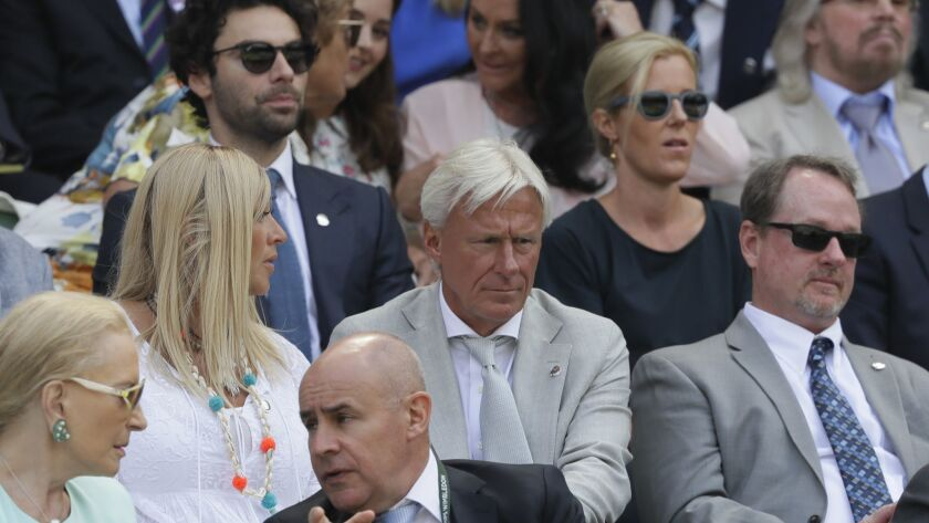 Former Wimbledon Champion Bjorn Borg, center, sits in the Royal Box on Centre Court ahead of the men