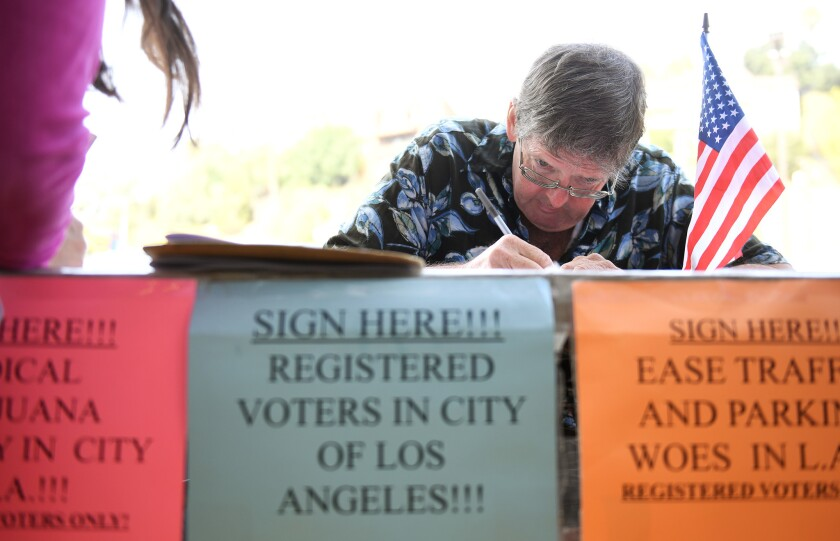 Tim Ecker collects signatures outside a grocery store in Silver Lake on Aug. 9, 2016.