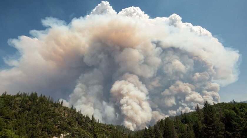 A large pyrocumulus cloud forms over the Carr fire near Redding, Calif., on July 27.