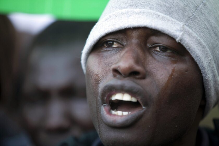An African migrant cries during a protest outside the Israeli parliament in Jerusalem.