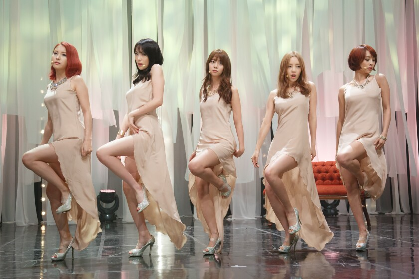 K-pop girl group Kara performs in Seoul in 2013. Goo Hara, second from right, died by apparent suicide in November.