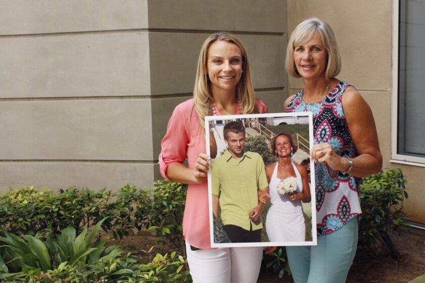 Kelsey Grover and Terri Wyatt holding a photo of Preston Grover.