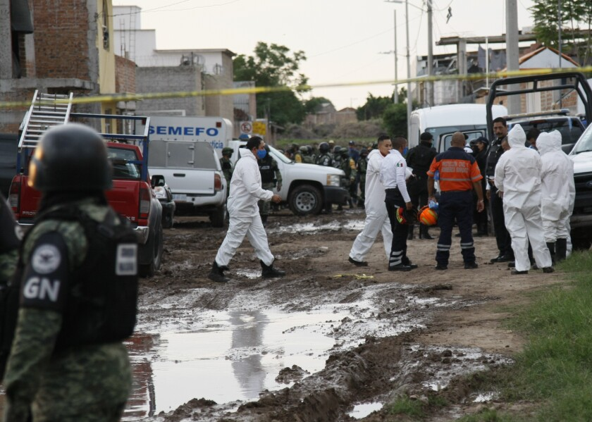 Investigators at the scene of a deadly attack at a drug rehabilitation center in Irapuato, Mexico.