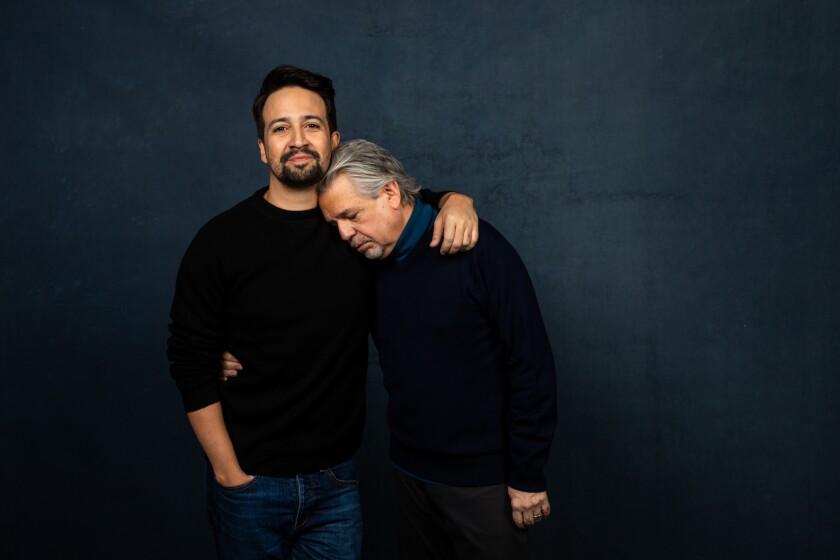Luis Miranda, right, rests his head on son Lin-Manuel Miranda's shoulder.