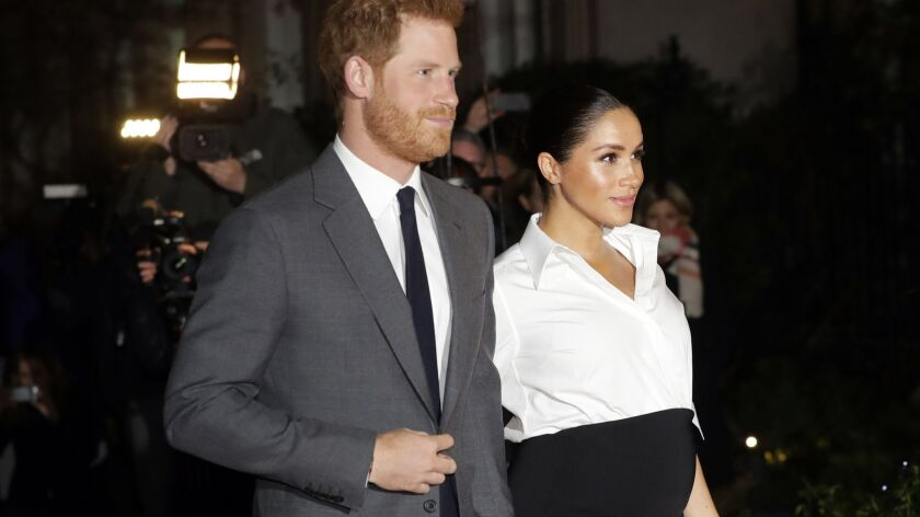 Britain's Prince Harry and Meghan, Duchess of Sussex, arrive at the annual Endeavour Fund Awards in London on Feb. 7.