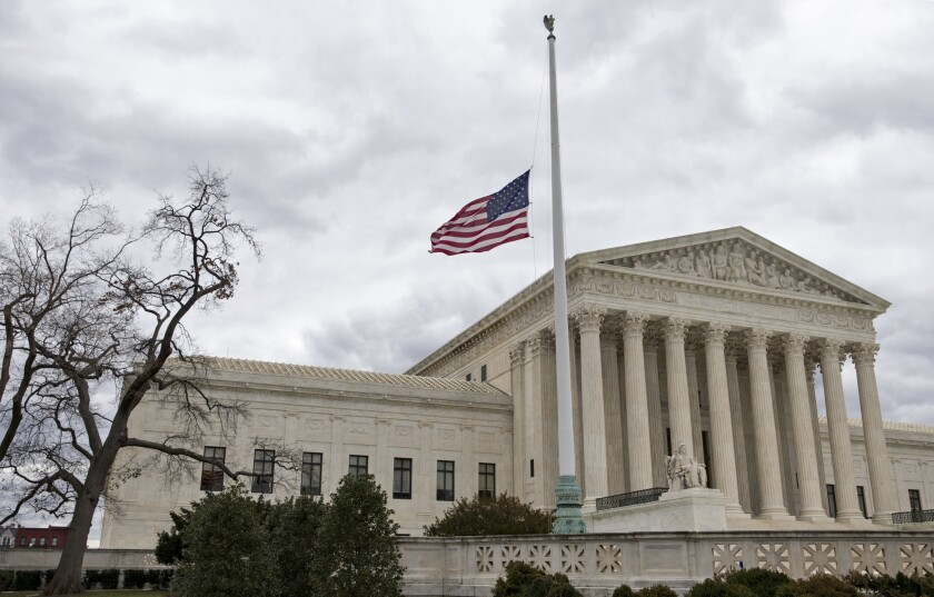 The flag in front of the U.S. Supreme Court flies at half-staff in February after the death of Justice Antonin Scalia, whose seat remains vacant.