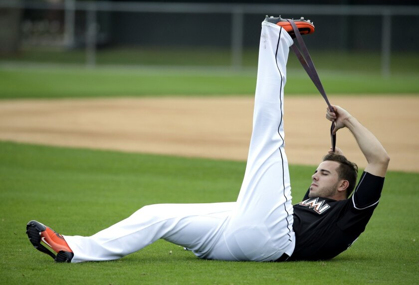 Miami Marlins pitcher Jose Fernandez stretches at the start of spring training baseball practice Friday, Feb. 19, 2016, in Jupiter, Fla. (AP Photo/Jeff Roberson)