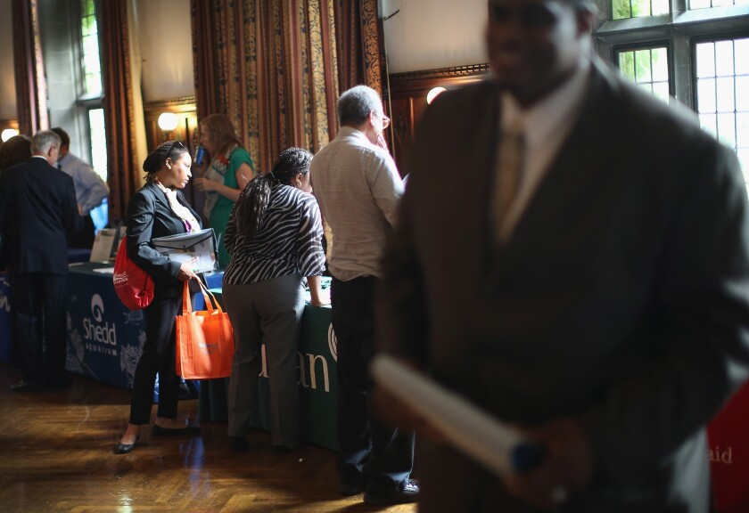 Military veterans search for work at a job fair in Chicago.