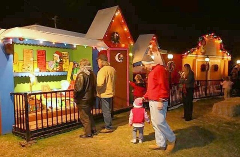 """The """"Snoopy House"""" Christmas display, pictured here, is being sent to Costa Mesa's City Hall since the home was foreclosed by Wells Fargo last week. The homeowner, Jim Jordan, has set up a trust that will financial aid in his lawsuit against the bank."""
