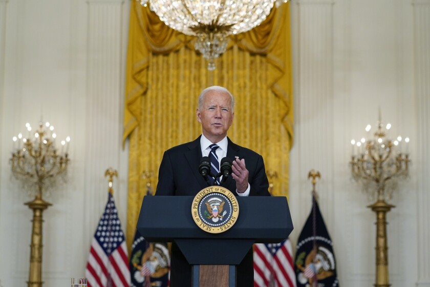 President Biden speaks from behind the presidential lectern at the White House