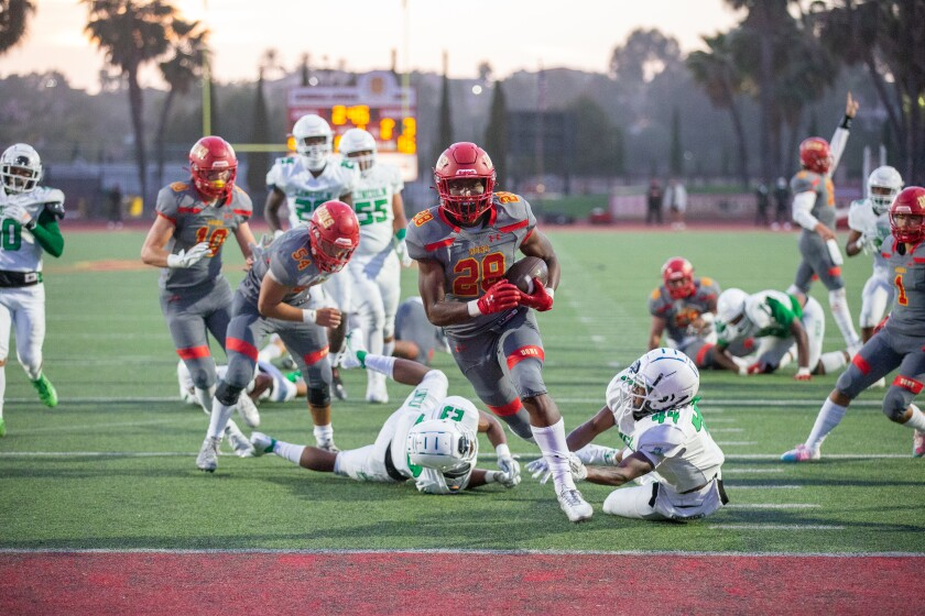 A Cathedral Catholic High player runs for a touchdown against Lincoln in Friday's 41-0 victory.