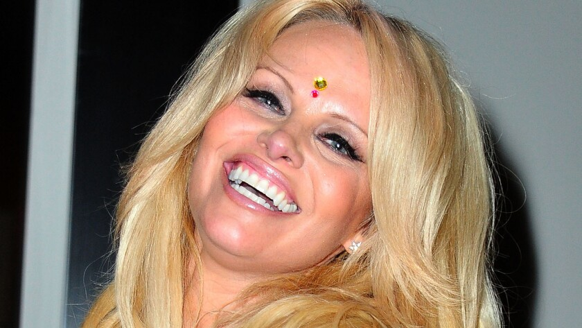 Pamela Anderson says a treatment she started in August has cured her of hepatitis C.