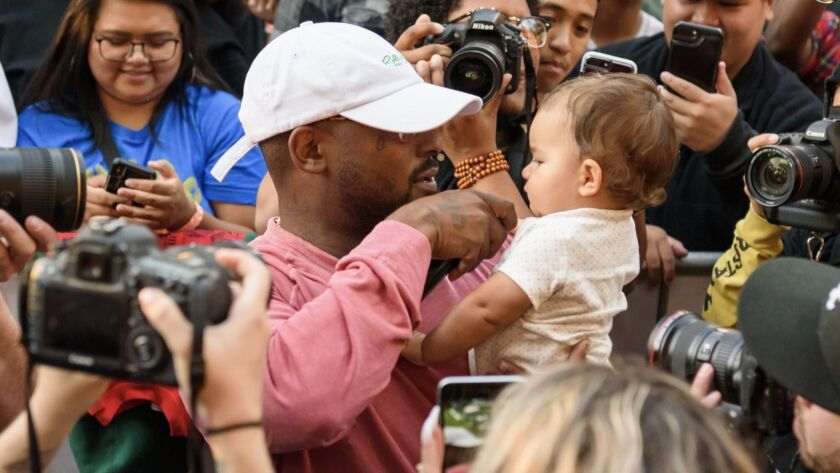 Schoolboy Q performs with baby from the crowd at .Paak House in the Park on Dec. 8, 2018, at MacArthur Park.