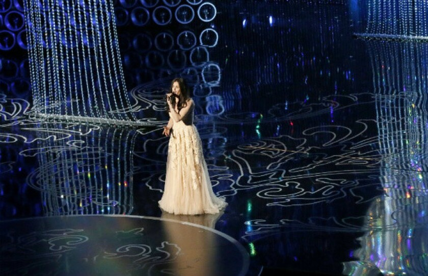 """Idina Menzel performs """"Let it Go"""" during the Academy Awards show at the Dolby Theatre in Los Angeles."""