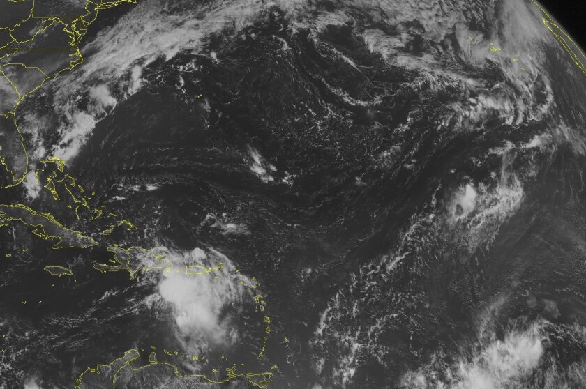 This NOAA satellite image taken Friday, Aug. 28, 2015 at 9:45 AM EDT shows a poorly organized Tropical Storm Erika located just to the Southwest of Puerto Rico. Erika currently has winds of 50 miles an hour and is producing heavy rainfall over Hispaniola and the surrounding islands in the Eastern Caribbean. Erika will continue moving to the west-northwest over Hispaniola. Fair weather can be expected across the rest of the Caribbean with only typical summertime showers and thunderstorms. (Weather Underground via AP)