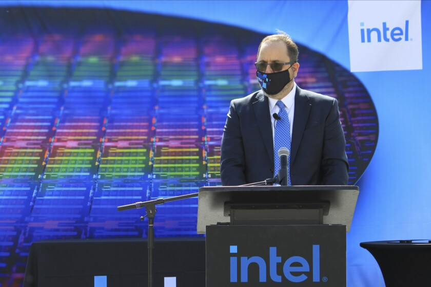 Intel Senior Vice President for Manufacturing and Operations Keyvan Esfarjani announces the company's plans to invest $3.5 billion in its New Mexico operations during a news conference Monday, May 3, 2021 in Rio Rancho, New Mexico. The company will modernize its Rio Rancho plant so can begin producing an advanced packaging system that will allow for stacking tiles to make better performing and more capable microchips. (AP Photo/Susan Montoya Bryan)