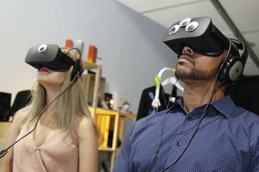 Blind daters Sarah Sharples and Jonathan Alvarado explore a virtual reality tour called Transitions at Wonderspaces in Mission Valley.