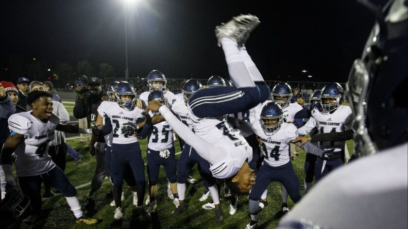 Sierra Canyon wide receiver Chayce Edwards-Morgan (22) does a backflip while celebrating with his team.