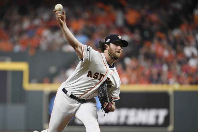 Astros pitcher Gerrit Cole delivers against the Rays in Game 2 the ALDS in Houston on Saturday.