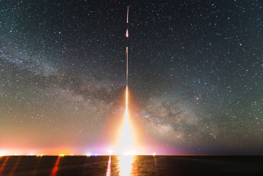 This time-lapse photograph shows NASA's Cosmic Infrared Background Experiment rocket launch last year. Data from the experiment show that half the extra-galactic background light is coming from rogue stars kicked out of their galaxies.