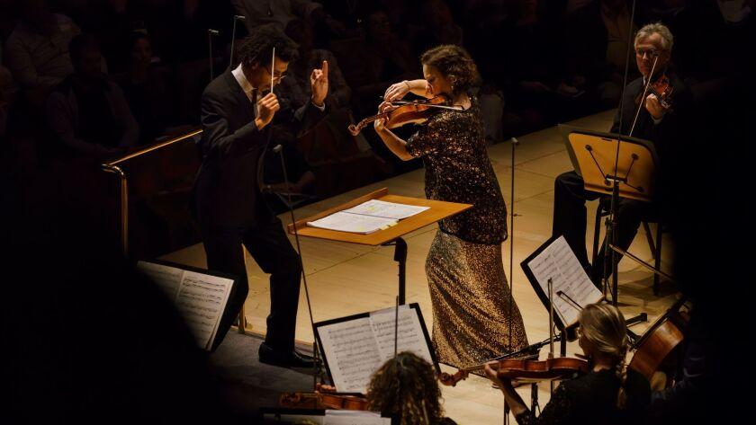 LOS ANGELES, CALIF. -- SUNDAY, DECEMBER 3, 2017: conductor Jonathon Heyward and violin soloist Hilar