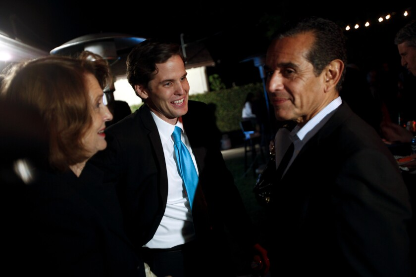On election night, former L.A. Mayor Antonio Villaraigosa, right, showed his support for Marshall Tuck in the race for state superintendent of public instruction over incumbent Tom Torlakson.
