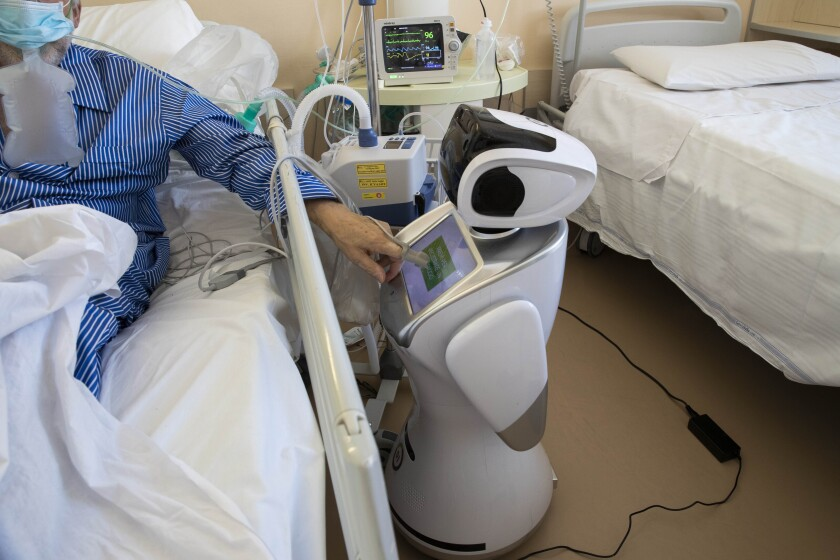 A robot attends to a COVID-19 patient