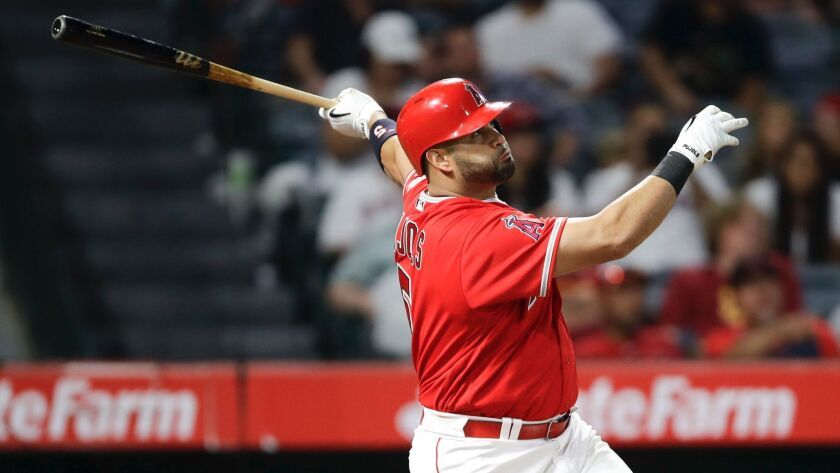 Los Angeles Angels' Albert Pujols watches his three-run home run against the Texas Rangers during th