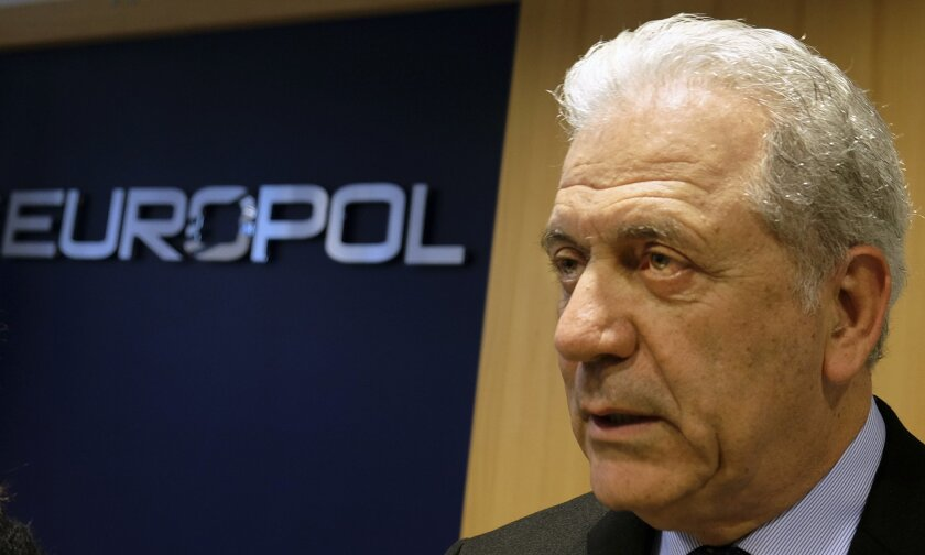 Dimitris Avramopoulos, EU Commissioner for Migration, Home Affairs and Citizenship, answers questions of reporters at the Europol headquarters in The Hague, Netherlands, Monday, Feb. 22, 2016. The European Union's police organization has launched a new unit dedicated to tackling migrant smuggling as part of the 28-nation bloc's efforts to stem the flow of people pouring into the continent as they flee conflict and poverty. Europol director Rob Wainwright said Monday his organization estimates that nine out of every 10 asylum-seekers arriving in Europe have their travel facilitated by a criminal smuggling network. (AP Photo/Mike Corder)