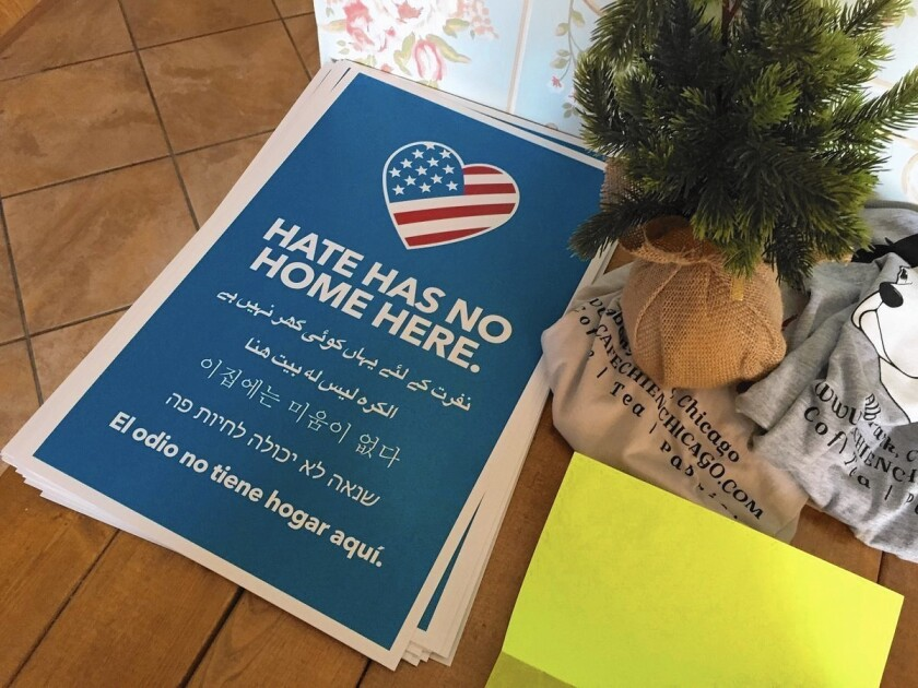 "The ""Hate has no home here"" campaign includes posters like these in Cafe Chien, a coffee shop in Albany Park."