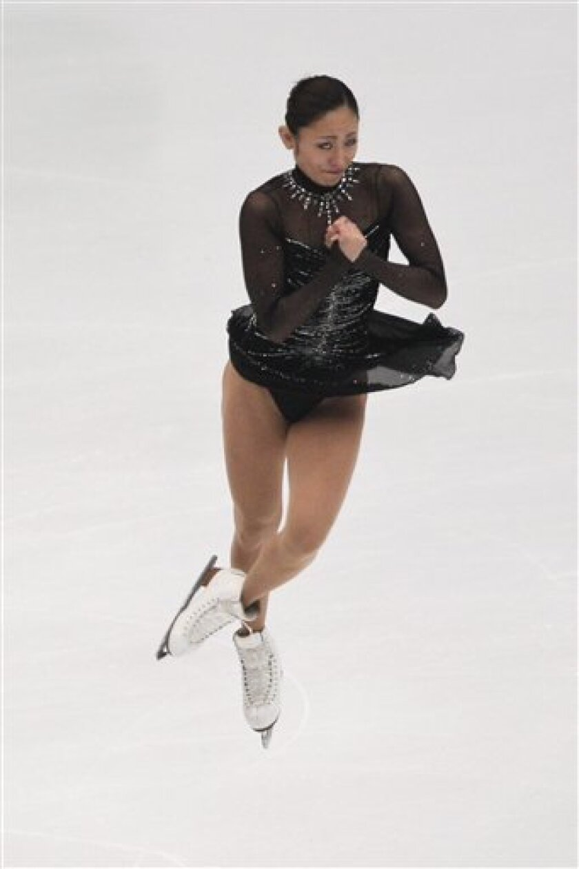 Japan's Miki Ando spins in ladies free skating during Cup of China 2010 figure skating competition in Beijing, Saturday, Nov. 6, 2010. (AP Photo/Alexander F. Yuan)