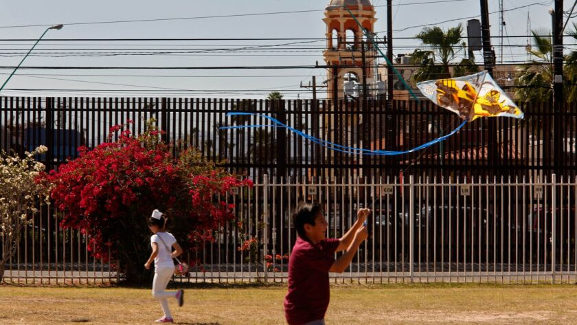 CALEXICO, CA - MARCH 31, 2017 -- A Calexico Mission School student runs with a kite during recess a