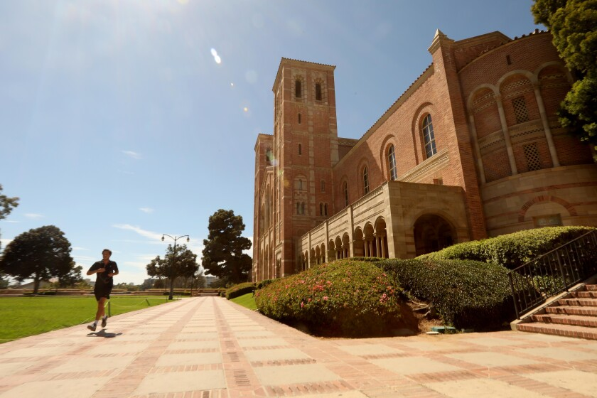 A jogger in front of a brick building at UCLA