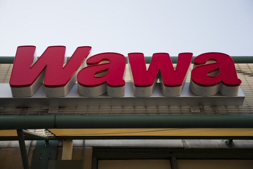 """FILE - This April 2, 2015 file photo shows a Wawa convenience store in Philadelphia. To celebrate its newest store opening in Delaware County, Pa., where the Kate Winslet-led crime drama """"Mare of Easttown"""" is set, Wawa is dedicating Thursday, June 10, 2021, as """"Mare of Easttown Day,"""" an homage to the show that introduced the world to the coffee and hoagies Pennsylvanians have loved for years. (AP Photo/Matt Rourke, File)"""